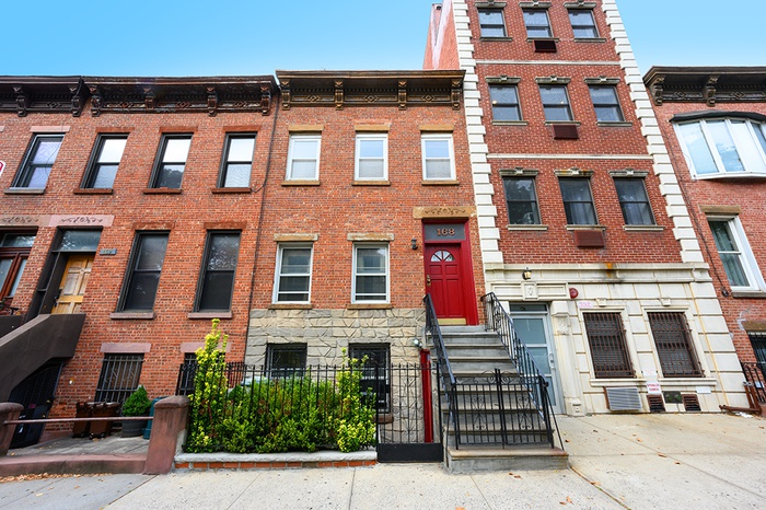 Charming 2-family townhouse situated across the street from Prospect Park